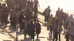 Faysh Khabur, Iraq (CNN) -- In an exodus of almost biblical proportions, thousands trudge across a river to escape killers belonging to the ...