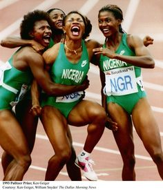 The 1992 Nigerian women's 4x100m relay team as they react to the scoreboard announcing their bronze medal victory at the Bacelona Olympics of 1992.