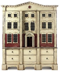 a painted press in the form of a doll's house - sold at Christie's