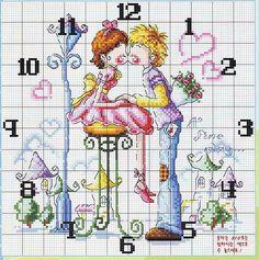 orologio punto croce con due innamorati