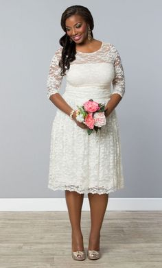 For the more casual bride, opt for our plus size Aurora Lace Wedding Dress.  It's short, comfortable and stunning!  www.kiyonna.com  #KiyonnaPlusYou  #MadeintheUSA  #BridalStyle