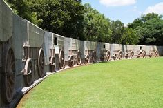A 'laager' of 64 granite ox-wagons surrounds the main block of the Monument and at the entrance stands a bronze sculpture of a Voortrekker mother and her children created by Anton van Wouw. This was also the last major work by the sculptor Anton Van, African Sculptures, Pretoria, Bronze Sculpture, Ox, Granite, South Africa, Entrance, 1960s