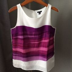 White with pink and purple designs top.ANN Taylor Very modern white top with purple and different pink designs:) zips up in the back and is in perfect condition! Ann Taylor Tops
