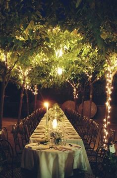 Canopy within the marquee over one of the tables, illuminated with fairy lights as it gets dark?
