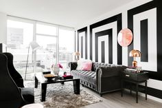 What's black and white and modern all over? For a PhD candidate in San Francisco, Homepolish's Michael Hilal designed a stark and minimalist modern apartment.