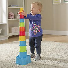 "Castle Nesting Stacking Toy: Stack, nest, match, sort! Toddlers can't keep their hands off this 18-piece stacking toy, which forms a giant 28""H tower. Playset includes 11 stacking cups, five sorting blocks, and a castle-shaped base with shape-sorter lid that forms a clever storage bin."