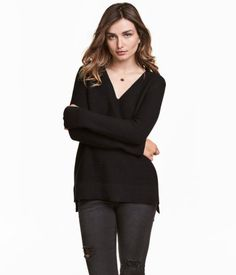 Black. Sweater in garter-stitch, cotton-blend knit fabric with a loose fit. V-neck, ribbing at cuffs and hem, and slightly longer back section.