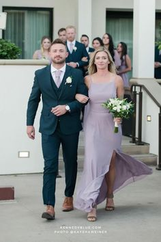 A cut out back, spaghetti straps, and sheer side panels, make the Alice dress from Kennedy Blue, the perfect mix of modern and classy. A slim A-line shape with a glamorous slit brings flowing chiffon to a new level of elegance. Get yours today! And the color 'French Lilac' Is the perfect shade of light purple to pair with navy blue groomsmen suits and simple greenery bouquets with white roses for a beachfront wedding!   dusty purple   muted purple   bridesmaid dress ideas   purple wedding theme Blue Groomsmen Suits, Bridesmaids And Groomsmen, Bridesmaid Dresses, Wedding Dresses, Dusty Purple, Light Purple, Greenery Bouquets, Pastel Weddings, French Lilac