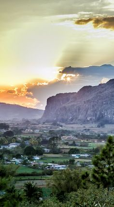 Sunset over the landscape of Viñales Valley, Cuba. The photo was taken By Lina Stock on the Divergent Travelers Photography Tour in Cuba. The Divergent Travelers Adventure Travel blog showcases great stories and some of the best travel photography in the world. We run photography tours not just in Cuba but throughout the world. Click to see more about Cuba  http://www.divergenttravelers.com/horseback-riding-vinales-valley-cuba/