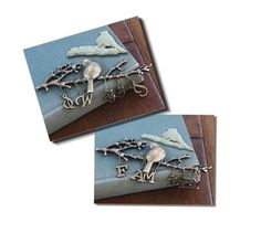 """Prima  little birds perched on branches in an antiqued finish. Two little phrases swing below; """"Sweet"""" and """"Family."""