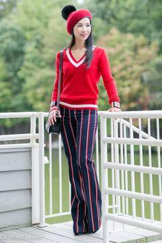 Thom Browne club sweater & Altuzarra stripe pants, fur pom pom hat