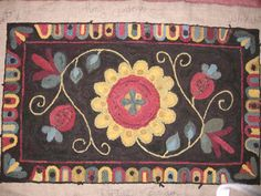 Hand hooked rug; pattern by Searsport Rugs