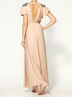 Bringing sexy back in this champagne maxi.