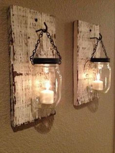 Mason jars turned into sconces, perfect! The rustic wood they are mounted too really completes this look.