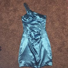 Turquoise One Shoulder Dress This dress is to die for. Would be prefect for prom or a semi formal event even. It has a very detailed one shoulder strap and is an amazing aquaish blue color that definitely shines all on its own B. Darlin Dresses One Shoulder