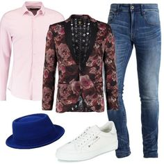 Jeans skinny alla caviglia, camicia rosa, giacca slim in fantasia floreale, sneakers basse John Galliano e cappello in lana. Uno stile unico per non passare inosservati.
