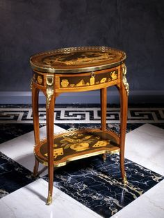 A Louis XVI table à écrire by Charles Topino Gilt bronze mounted oak-lined tulipwood, kingswood, amaranth, tulipwood and various fruitwoods marquetry Height 75 cm, width 57 cm, depth 40.5 cm.