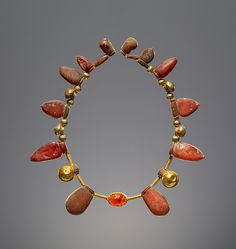 Necklace with a Pendant Scarab, Italic or Etruscan, 550–400 B.C. Amber, gold, and carnelian.