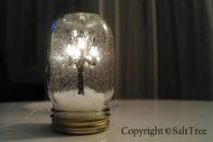 I love snow-globes, and this is a really neat DIY one that uses a battery operated decorative lamp post.
