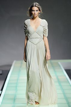 Doric chiton with plunged neckline, girdled at the waist with ruffled sleeves
