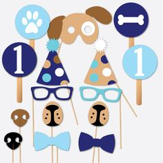 What a perfect way to celebrate a 1st birthday! With this pawty dog themed photobooth prop set, you will enjoy fully assembled pieces (all the sticks are attached) right out of the box. A 15 piece collection, this Photo Booth Set includes the following full size pieces: 2-Blue Bowties 2-Blue Glasses 1-Pawprint Circle 1-Dog Bone Circle 2-Circles with the number 1 2-Noses (black and brown) 2-Dog Nose/Mouths 2-Polka Dot Party Hats 1-Dog Mask Each photo prop is made with thick car...