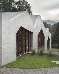 Cement exteriors. Wooden doors. Priceless  view.  Confignon House / LOCALARCHITECTURE