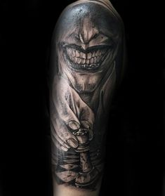 Horror style detailed arm tattoo of creepy man with chess board figure