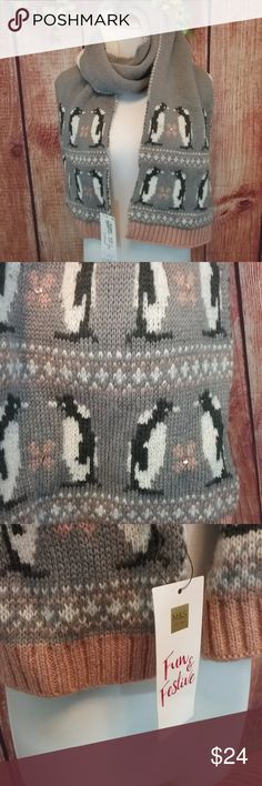 NWT M&S Knitted Penguin Scarf NWT M&S thick & cozy, smoke gray knitted scarf. It features penguins and flowers adorned with sequins. This is bordered by dusty rose and white designs.  Brand Marks & Spencer Condition NWT 100% Acrylic Inv # E40 Marks & Spencer Accessories Scarves & Wraps