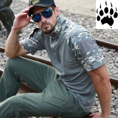 Be ready to head bush with the FDO Camouflage T-Shirt. Semi camouflage across the sleeves and collar and plain on the torso, made from polyester and cotton for breathability and quick drying this is an ideal shirt if you intend on adding your own logo. Camouflage T Shirts, Camouflage Colors, Mens Sunglasses, Free Shipping, Sleeves, Clothing, Cotton, Hiking, Valentines