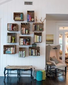 Want a book nook for a hallway? Hang baskets and add a bench!