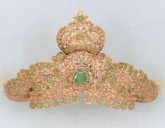 EMERALD, DIAMOND AND ROSE GOLD tiara: 65 cabochon emeralds, typical eye-visible and surface reaching inclusions, several emeralds deficient, 82 table-cut diamonds, fair to good color and clarity, 9½ ins., 58.7 dwt, 91.2 g, repair evident. Part of a set that includes a belt. Sold by Christie's, 2005