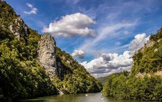 Portile de Fier Natural Park, or Iron Gate Park, is a hidden Romanian treasure. Nature-lovers, history buffs and curious travelers will love this hidden. Romania Travel, Rock Sculpture, Natural Park, Iron Gates, Explore, Mountains, Water, Outdoor, Moldova