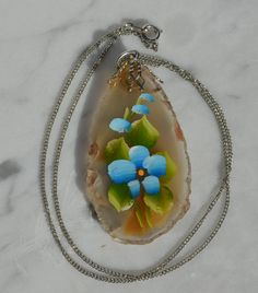 Hand painted flowers on geoids necklace jewelry by MandaWolf, $17.00