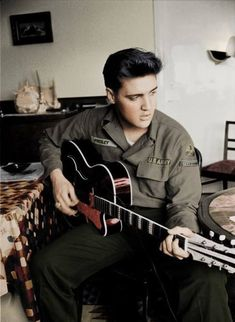 Elvis Presley army pic. I don't I've ever seen this pic in color/colorized. Love it