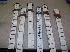 Snow Sticks - Gather enough paint sticks for your class. Put students' names on the back with a sharpie. Students paint one side of their stick white. Once sticks are dry, students use unifix cubes to measure 1-inch marks on their sticks. Once they finished all their markings (I told them to go to 10), they drew on a face. I passed out sharpies for the students to trace their marks/numbers/faces. Decorate snowman using different materials.  Hot glue gun may be needed depending on materials.