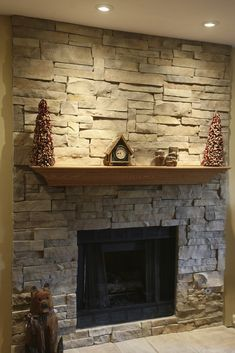 Interesting Stone Fireplace Designs With Simple Oak Shelf Mantel Under Shining Ceiling Lamps