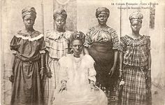 Postcards from 1900-1910 by the photographer F.W.H Arkhurst. His studio photographs capture the then-fashionable style of  women's dress along the African coast from the Niger Delta to the Ivory Coast as families grew prosperous from trading opportunities in the expanding colonial economies. Hair was swept high and adorned with gold jewellery or wrapped in cloth, tailored dress was of imported cotton prints, often with a shawl or wrap of locally woven fabrics.