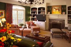 Equestrian Chic:Horse painting, and silver riding trophies all permeate this room designed by Lee W. Robinson.
