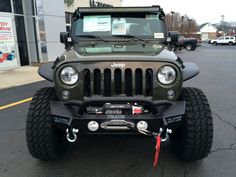 2016 Jeep Wrangler Unlimited front view with accessory LED lights off