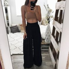 High waisted wide leg pants with draped pleating on front. (100% Polyester) shop the look: MOTO JACKET + CROP TOP Model is wearing small. Height: 5'7 Approximate Measurements: these measurements are not exact. Trousers S/M/L (Inner seam 30 Inches) & (Outer Seam 44 Inches) Small: Waist 11-12 Inches Medium: Wai