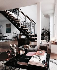 I love this living space. I couldn't live in a place without lots of light and this space uses natural light so beautifully