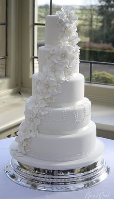 5 petal flower cascade cake by Cotton and Crumbs, via Flickr