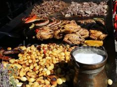 Grilled meats - pork sausages, chicken, skewers, potatoes and red pepper. Coarse salt in bowl of corner. Pork Sausages, Chicken Skewers, Grilled Meat, Red Peppers, Pot Roast, Grilling, Corner, Potatoes, Carne Asada