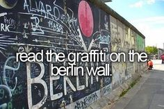 Read the graffiti on the berlin wall
