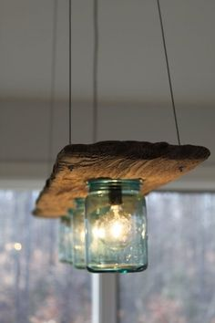 Check out this cool rustic wooden board and mason jar chandelier @istandarddesign