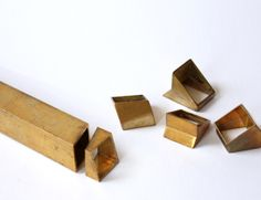 Dana Bachar: IndustRing  A collection of rings inspired of an industrial production process. Creating a desirable piece of jewelry with a luxurious look, which is designed for an industrial production line. By cutting brass rectangular profiles in different angles, and reconnecting the pieces in various ways
