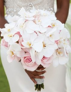 this bouquet reminds me of jess...strong, delicate, lady, classic, playful Blush Rose & White Orchid Bridal Bouquet
