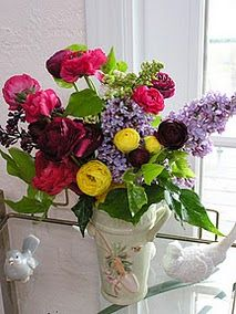 Ranunculus and lilacs.