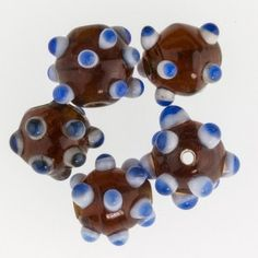 Amber round with white and blue horns. 12mm  Pkg of 6. b11-mi-0107(e)