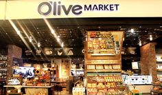 The new IFC Mall Seoul in Yeouido houses a nine-theater CGV complex, 35 new restaurants and the first Apple outlet (Frisbee) in southwest Seoul.  Here, tasty food beckons shoppers to Olive Market, a grocery store offering premium products.